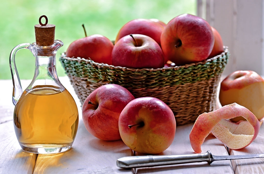 Apply apple cider vinegar - Lighten Hair Without Bleach